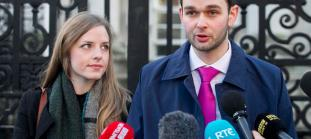 Daniel and Amy McArthur of Ashers Baking Company, talk to the media outside Belfast High Court as the Christian bakery owners who were found guilty of discriminating against a gay man are appealing against the court ruling to protect all family businesses with deeply held convictions. PRESS ASSOCIATION Photo. Picture date: Wednesday February 3, 2016. The McArthur family's refusal to bake the customer's order for a cake bearing a pro-gay marriage slogan was ruled unlawful by Belfast County Court last year. See PA story ULSTER Cake. Photo credit should read: Liam McBurney/PA Wire