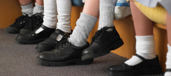 Students Sitting In Row In Classroom